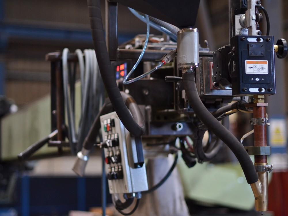 Foto del brazo passini con la máquina de soldar